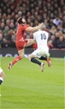 06.02.15 - Wales v England-  Leigh Halfpenny of Wales and Mike Brown of England  compete for high ball .