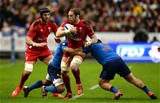28.02.15 - France v Wales - RBS 6 Nations 2015 - Alun Wyn Jones of Wales is tackled by Wesley Fofana and Rabbah Slimani of France.