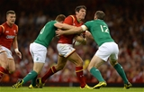 08.08.15 - Wales v Ireland - Dove Men Series 2015 -James Hook of Wales is tackled by Paddy Jackson and Darren Cave of Ireland.