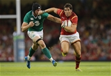 08.08.15 - Wales v Ireland, Dove Men Tests 2015 - James Hook of Wales looks to hold off Tommy O'Donnell of Ireland