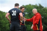 03.09.15 -  Wales Rugby Training -Alex Cuthbert and George North talk to Warren Gatland during training.