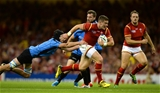 20.09.15 - Wales v Uruguay - Rugby World Cup 2015 -Scott Williams of Wales gets past Alejandro Nieto of Uruguay.