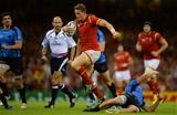 20.09.15 - Wales v Uruguay - Rugby World Cup 2015 -Hallam Amos of Wales beats tackle by Alejandro Nieto of Uruguay.