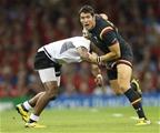 01.10.15 - Wales v Fiji, Rugby World Cup 2015 - James Hook of Wales takes on Aseli Tikoirotuma of Fiji