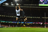 01.10.15 - Wales v Fiji - Rugby World Cup 2015 -Ben Volavola of Fiji and Alex Cuthbert of Wales compete in the air.