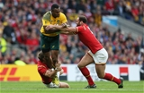 10.10.15 - Australia v Wales - Rugby World Cup - Tevita Kuridrani of Australia is tackled by Dan Biggar and Jamie Roberts of Wales.