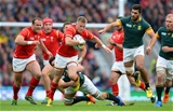 17.10.15 - South Africa v Wales - Rugby World Cup Quarter Final 2015 -Gareth Anscombe of Wales is tackled by Schalk Burger of South Africa.