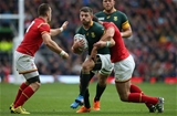17.10.15 - South Africa v Wales, Rugby World Cup 2015 Quarter Final - Willie le Roux of South Africa is tackled by Jamie Roberts of Wales