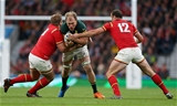17.10.15 - South Africa v Wales - Rugby World Cup Quarter Final - Duane Vermeulen of South Africa is tackled by Tomas Francis and Jamie Roberts of Wales.