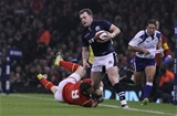 13.02.16 - Wales v Scotland - RBS 6 Nations -Stuart Hogg of Scotland is tackled by Gareth Davies of Wales