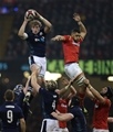 13.02.16 - Wales v Scotland, RBS 6 Nations 2016 - Jonny Gray of Scotland takes the ball as Taulupe Faletau of Wales challenges