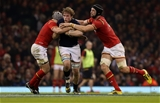 13.02.16 - Wales v Scotland - RBS 6 Nations 2016 - Jonny Gray of Scotland is tackled by Jonathan Davies and Luke Charteris of Wales.