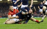 13.02.16 - Wales v Scotland, RBS 6 Nations 2016 - Duncan Taylor of Scotland beats Gareth Davies of Wales to score try