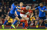 26.02.16 - Wales v France - RBS 6 Nations 2016 -Jonathan Davies of Wales takes on Maxime Mermoz of France.