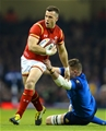 26.02.16 - Wales v France - RBS 6 Nations 2016 -Gareth Davies of Wales holds off Paul Jedrasiak of France.
