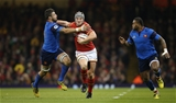 26.02.16 - Wales v France, RBS 6 Nations Championship 2016 - Jonathan Davies of Wales holds off Damien Chouly of France