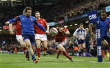 26.02.16 - Wales v France, RBS 6 Nations Championship 2016 - Maxime Medard of France kicks the ball clear as Liam Williams of Wales is about to dive in to score