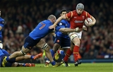 26.02.16 - Wales v France - RBS 6 Nations - Jonathan Davies of Wales is tackled by Antoine Burban of France.