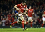 26.02.16 - Wales v France - RBS 6 Nations - Sam Warburton of Wales is tackled by Maxime Mermoz of France.
