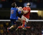 26.02.16 - Wales v France - RBS 6 Nations - Maxime Medard of France and Liam Williams of Wales leap for the ball.