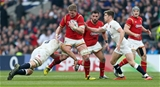 12.03.16 - England v Wales - RBS 6 Nations - Bradley Davies of Wales is tackled by Chris Robshaw of England.