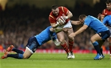 19.03.16 - Wales v Italy - RBS 6 Nations - Rob Evans of Wales is tackled by Sergio Parisse and Andrea Lovotti of Italy.