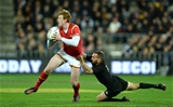 18.06.16 - New Zealand v Wales - Steinlager Series, Second Test -Rhys Patchell of Wales is tackled by Aaron Cruden of New Zealand.