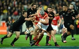 18.06.16 - New Zealand v Wales - Steinlager Series, Second Test -Jonathan Davies of Wales is tackled by Ben Smith, Dane Coles and Aaron Smith of New Zealand.