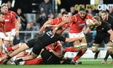 25.06.16 - New Zealand v Wales - Steinlager Series, Third Test -Taulupe Faletau of Wales beats tackle by Tawera Kerr-Barlow of New Zealand.