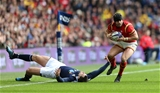 25.02.17 - Scotland v Wales - RBS 6 Nations Championship - Leigh Halfpenny of Wales breaks away from Tim Visser of Scotland.