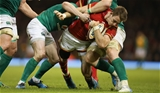 10.03.17 - Wales v Ireland, 2017 RBS 6 Nations Championship -  Liam Williams of Wales  is held