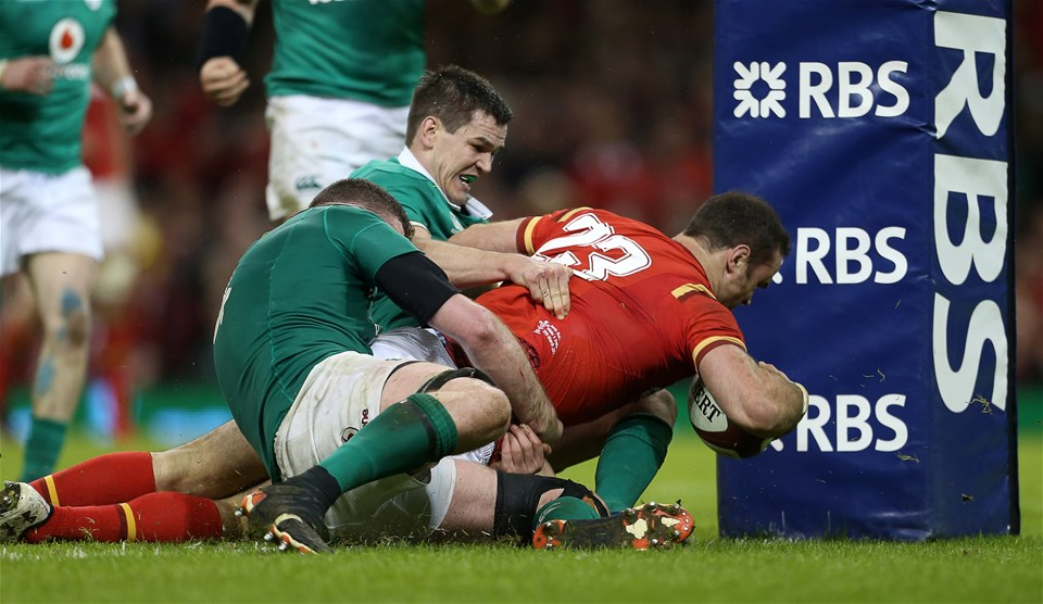 10.03.17 - Wales v Ireland - RBS 6 Nations Championship - Jamie Roberts of Wales can't be stopped by Johnny Sexton of Ireland to charge over and score a try.