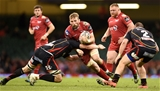 15.04.17 - Newport Gwent Dragons v Scarlets - Guinness PRO12 -John Barclay of Scarlets is tackled by Cory Hill of Newport Gwent Dragons.