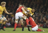 11.11.17 - Wales v Australia, Under Armour Series 2017 - Samu Kerevi of Australia is tackled by Aaron Shingler of Wales and Alun Wyn Jones of Wales