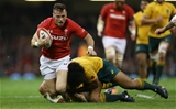 11.11.17 - Wales v Australia - Under Armour Series 2017 - Gareth Davies of Wales is tackled by Reece Hodge and Tatafu Polota-Nau of Australia.