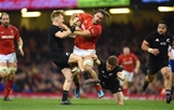 25.11.17 - Wales v New Zealand - Under Armour Series -Josh Navidi of Wales is tackled by Beauden Barrett and Damian McKenzie of New Zealand.