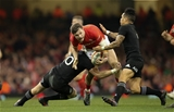 25.11.17 - Wales v New Zealand, Under Armour 2017 Series - Steff Evans of Wales takes on Beauden Barrett of New Zealand and Aaron Smith of New Zealand