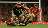 25.11.17 - Wales v New Zealand - Under Armour Series 2017 - Josh Navidi of Wales is tackled by Samuel Whitelock of New Zealand.
