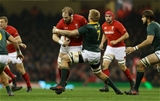 02.12.17 - Wales v South Africa - Under Armour Series 2017 - Alun Wyn Jones of Wales is tackled by Pieter-Steph du Toit of South Africa.
