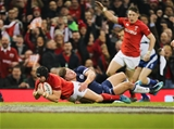 03.02.18 - Wales v Scotland, NatWest 6 Nations - Leigh Halfpenny of Wales beats Huw Jones of Scotland as he powers over to score try