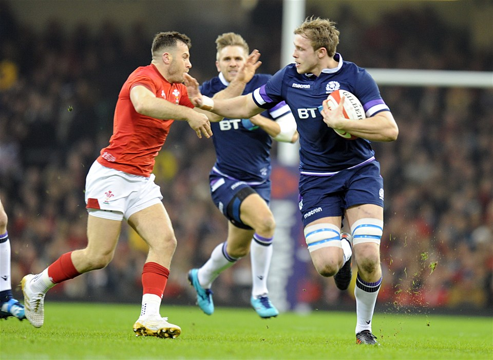 03.02.18 - Wales v Scotland - NatWest 6 Nations -Jonny Gray of Scotland holds off Gareth Davies of Wales