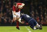 03.02.18 - Wales v Scotland, NatWest 6 Nations - Scott Williams of Wales gets past Ben Toolis of Scotland