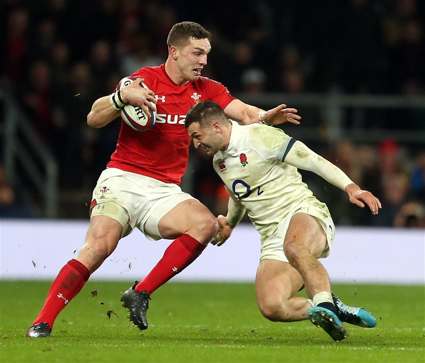 10.02.18 - England v Wales - Natwest 6 Nations - George North of Wales side steps Jonny May of England.