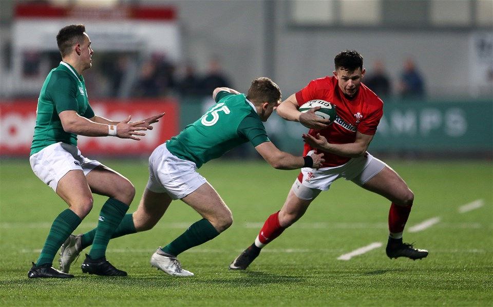 23.02.18 - Ireland U20s v Wales U20s - Natwest 6 Nations - Tommy Rogers of Wales is tackled by Michael Silvester of Ireland.