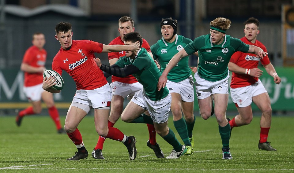23.02.18 - Ireland U20s v Wales U20s - Natwest 6 Nations - Tommy Rogers of Wales is tackled by Harry Byrne of Ireland.