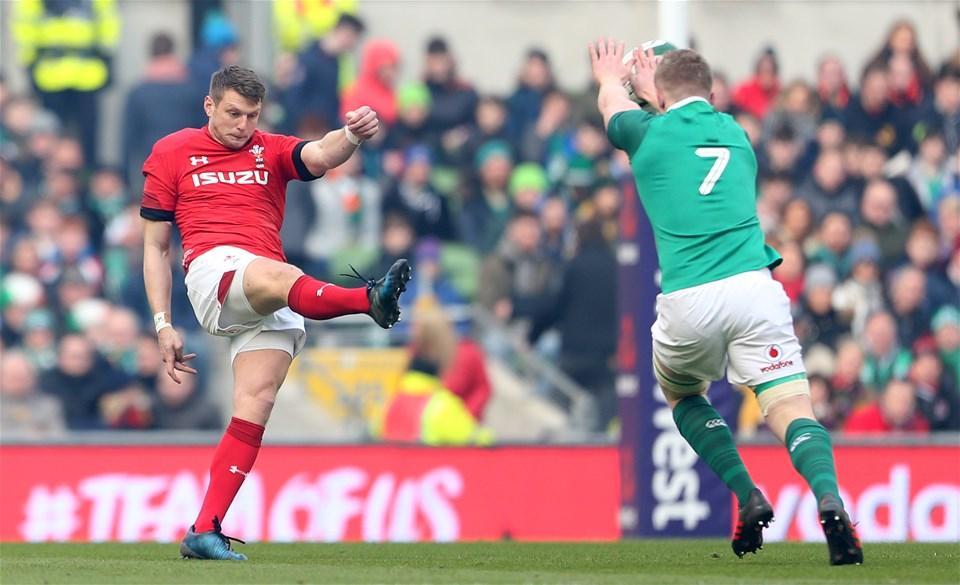 24.02.18 - Ireland v Wales - Natwest 6 Nations - Dan Biggar of Wales kicks past Dan Leavy of Ireland.