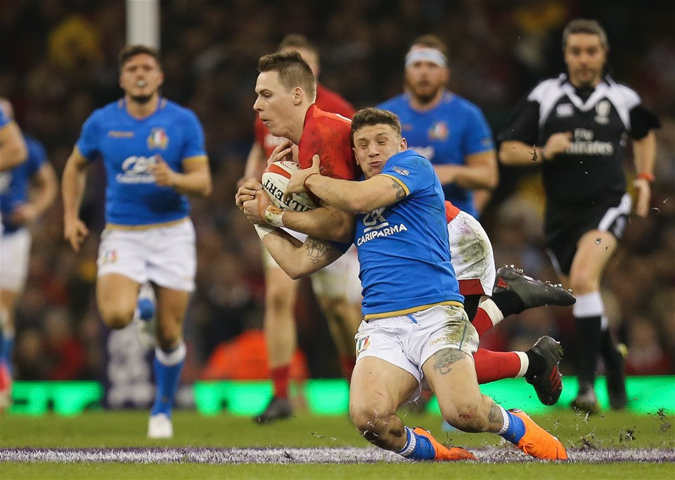 11.03.18 - Wales v Italy, NatWest 6 Nations 2018 - Liam Williams of Wales and Matteo Minozzi of Italy compete for the ball