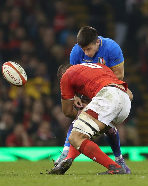 11.03.18 - Wales v Italy - Natwest 6 Nations Championship - Tommaso Allan of Italy is tackled by Taulupe Faletau of Wales.