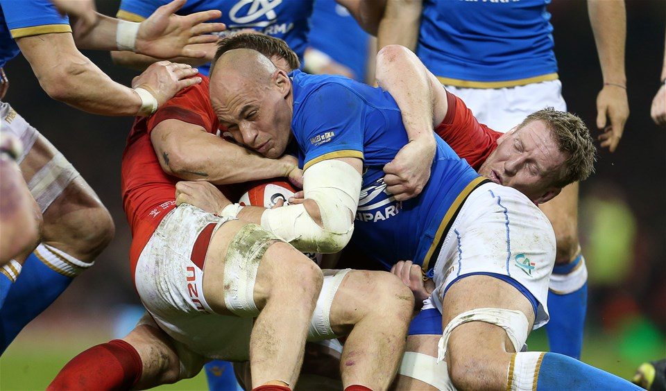11.03.18 - Wales v Italy - Natwest 6 Nations Championship - Sergio Parisse of Italy is taken down by James Davies and Bradley Davies of Wales.