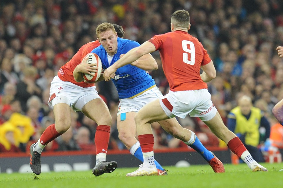 11.03.18 - Wales v Italy - NatWest 6 Nations Championship - Giulio Bisegni of Italy  is tackled by Owen Watkin of Wales and Gareth Davies of Wales